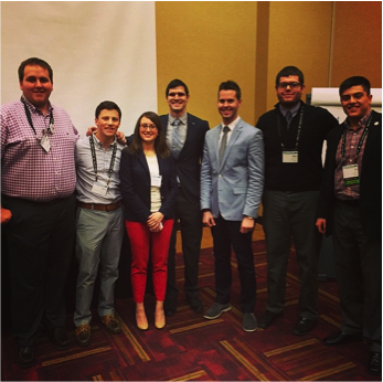 Chelsea Bowers, director of development for RAINN, poses with members of NIC while at a conference