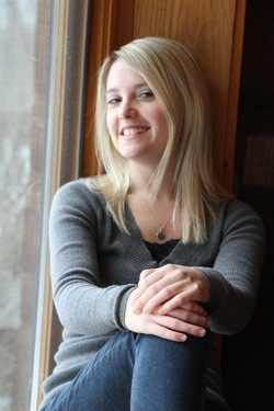 Erin Merryn, advocate for Erin's Law, sits near a window.