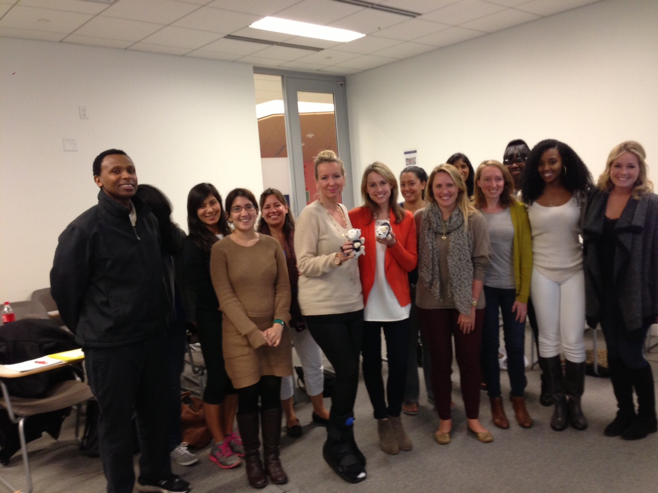 Journalism master's student pose with Katherine Hull Fliflet, RAINN's vice president of communications, and Liz Seccuro, member of RAINN's speakers bureau