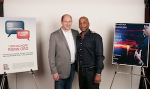 RAINN president Scott Berkowitz and musician Rahsaan Patterson pose together
