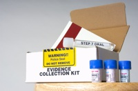 "A white box and set of vials on a table labeled ""Evidence Collection Kit"""