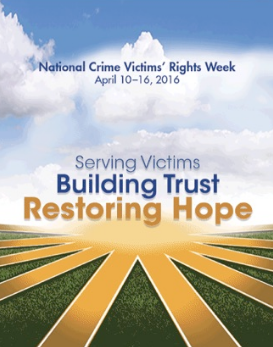"Promotional poster reading ""National Crime Victims' Rights Week, April 10-16, 2016. Serving Victims, Building Trust, Restoring Hope."" Words printed over rays of sunshine, clouds, and a green field."