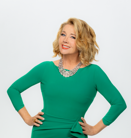 Melody Thomas Scott poses in a green dress